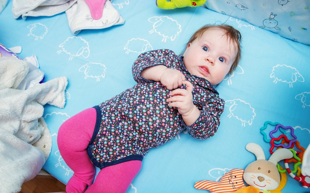 What causes flat spots to develop on a baby's head?
